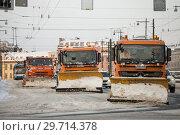 Купить «Автомобили снегоуборочной техники», фото № 29714378, снято 24 марта 2018 г. (c) Евгений Кашпирев / Фотобанк Лори
