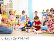 Купить «Children playing diverse musical toys. Early musical education in kindergarten», фото № 29714470, снято 18 января 2020 г. (c) Оксана Кузьмина / Фотобанк Лори