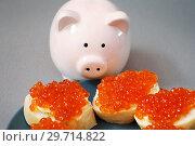 Купить «Бутерброды с красной икрой и фигурка поросёнка», фото № 29714822, снято 2 января 2019 г. (c) Dmitry29 / Фотобанк Лори
