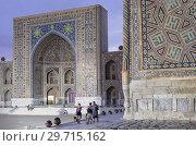 Купить «Tilla-Kari Medressa, at right facade of Sher Dor Medressa, Registan, Samarkand, Uzbekistan.», фото № 29715162, снято 24 июня 2019 г. (c) age Fotostock / Фотобанк Лори