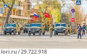 "Купить «Russia, Samara, May 2018: a column of army special armored vehicles ""Tiger"" in the city.», фото № 29722918, снято 5 мая 2018 г. (c) Акиньшин Владимир / Фотобанк Лори"