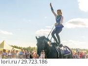 Купить «Russia, Samara, July, 2018: a Cossack girl rides a horse and performs tricks.», фото № 29723186, снято 29 июля 2018 г. (c) Акиньшин Владимир / Фотобанк Лори