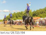 Купить «Russia, Samara, July, 2018: Cossack girls ride horses and perform tricks.», фото № 29723194, снято 29 июля 2018 г. (c) Акиньшин Владимир / Фотобанк Лори