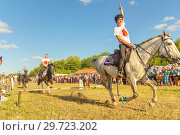 Купить «Russia, Samara, July, 2018: The Cossack rides a horse and performs tricks.», фото № 29723202, снято 29 июля 2018 г. (c) Акиньшин Владимир / Фотобанк Лори