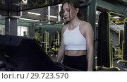 Купить «Beautiful Young Woman Athlete Walks On A Treadmill Ending An Exercise Session», видеоролик № 29723570, снято 20 мая 2019 г. (c) Pavel Biryukov / Фотобанк Лори