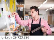 Купить «Portrait of craftsman in carpentry», фото № 29723826, снято 8 апреля 2017 г. (c) Яков Филимонов / Фотобанк Лори