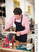 Купить «Joiner working on machine», фото № 29723830, снято 8 апреля 2017 г. (c) Яков Филимонов / Фотобанк Лори