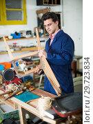 Man carpenter in furniture repair workshop. Стоковое фото, фотограф Яков Филимонов / Фотобанк Лори