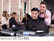 Купить «Hairstylist presenting result of his styling to male client», фото № 29723882, снято 5 марта 2018 г. (c) Яков Филимонов / Фотобанк Лори