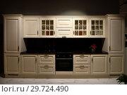 Купить «Beige kitchen set with stove in the room», фото № 29724490, снято 25 ноября 2018 г. (c) Володина Ольга / Фотобанк Лори