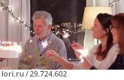 Купить «happy family having birthday party at home», видеоролик № 29724602, снято 7 января 2019 г. (c) Syda Productions / Фотобанк Лори