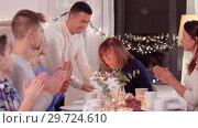 Купить «happy family having birthday party at home», видеоролик № 29724610, снято 14 января 2019 г. (c) Syda Productions / Фотобанк Лори
