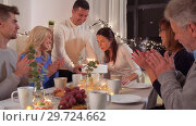 Купить «happy family having birthday party at home», видеоролик № 29724662, снято 7 января 2019 г. (c) Syda Productions / Фотобанк Лори