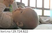 Купить «Active baby girl playing with toy on the floor», видеоролик № 29724822, снято 24 июня 2019 г. (c) Данил Руденко / Фотобанк Лори