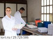 Купить «Adult woman holding carton tray with fresh eggs», фото № 29729586, снято 17 февраля 2019 г. (c) Яков Филимонов / Фотобанк Лори