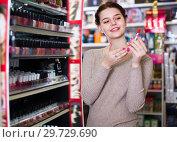 Купить «Positive female searching for reliable lipstick», фото № 29729690, снято 21 февраля 2017 г. (c) Яков Филимонов / Фотобанк Лори