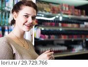 Купить «female customer looking for lipstick in cosmetics shop», фото № 29729766, снято 21 февраля 2017 г. (c) Яков Филимонов / Фотобанк Лори