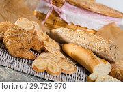 Купить «Baked goods on wicker mat», фото № 29729970, снято 30 января 2018 г. (c) Яков Филимонов / Фотобанк Лори