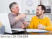 Купить «Mature man and agent sign rental agreement», фото № 29734694, снято 22 января 2019 г. (c) Яков Филимонов / Фотобанк Лори