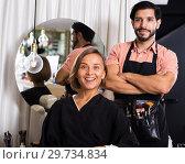 Купить «man makeup artist near client woman», фото № 29734834, снято 19 января 2019 г. (c) Яков Филимонов / Фотобанк Лори