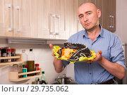 Купить «Nice man with dish of fried sturgeon», фото № 29735062, снято 6 февраля 2018 г. (c) Яков Филимонов / Фотобанк Лори