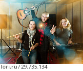 Купить «expressive group of rock musicians posing with instruments», фото № 29735134, снято 26 октября 2018 г. (c) Яков Филимонов / Фотобанк Лори