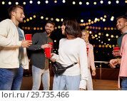 Купить «friends with drinks dancing at rooftop party», фото № 29735466, снято 2 сентября 2018 г. (c) Syda Productions / Фотобанк Лори
