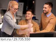 Купить «business team making thumbs up gesture at office», фото № 29735550, снято 26 ноября 2017 г. (c) Syda Productions / Фотобанк Лори