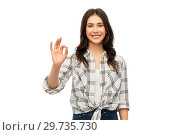 Купить «young woman or teenage girl in checkered shirt», фото № 29735730, снято 10 ноября 2018 г. (c) Syda Productions / Фотобанк Лори