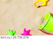 Купить «close up of sand toys kit on summer beach», фото № 29736074, снято 27 июня 2018 г. (c) Syda Productions / Фотобанк Лори