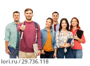 Купить «group of smiling students showing thumbs up», фото № 29736118, снято 10 ноября 2018 г. (c) Syda Productions / Фотобанк Лори