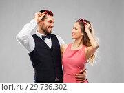 Купить «happy couple in heart-shaped sunglasses», фото № 29736302, снято 30 ноября 2018 г. (c) Syda Productions / Фотобанк Лори