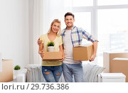 Купить «happy couple with boxes moving to new home», фото № 29736386, снято 25 февраля 2016 г. (c) Syda Productions / Фотобанк Лори