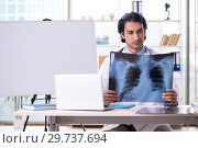 Купить «Young handsome male radiologist in front of whiteboard», фото № 29737694, снято 21 ноября 2018 г. (c) Elnur / Фотобанк Лори