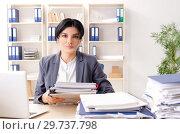 Купить «Middle aged businesslady unhappy with excessive work», фото № 29737798, снято 15 ноября 2018 г. (c) Elnur / Фотобанк Лори