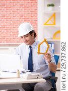 Купить «Construction supervisor working on blueprints», фото № 29737862, снято 13 сентября 2018 г. (c) Elnur / Фотобанк Лори