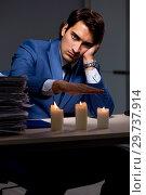 Купить «Businessman working late in office with candle light», фото № 29737914, снято 7 сентября 2018 г. (c) Elnur / Фотобанк Лори