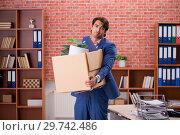 Купить «Young person being fired from his work», фото № 29742486, снято 10 сентября 2018 г. (c) Elnur / Фотобанк Лори
