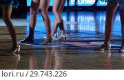 Купить «Women in sparkle costumes dancing for team supporting», видеоролик № 29743226, снято 23 июля 2019 г. (c) Константин Шишкин / Фотобанк Лори