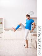 Купить «Leg injured young man with crutches at home», фото № 29743250, снято 19 сентября 2018 г. (c) Elnur / Фотобанк Лори