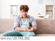 Купить «Young man committing suicide with razor blade», фото № 29743302, снято 25 сентября 2018 г. (c) Elnur / Фотобанк Лори