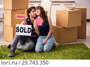 Купить «Young family selling their house», фото № 29743350, снято 21 сентября 2018 г. (c) Elnur / Фотобанк Лори