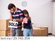 Купить «Young family selling their house», фото № 29743354, снято 21 сентября 2018 г. (c) Elnur / Фотобанк Лори