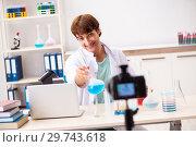 Купить «Chemist blogger recording video for his blog», фото № 29743618, снято 25 сентября 2018 г. (c) Elnur / Фотобанк Лори