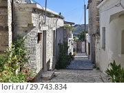 Купить «Narrow street in tourist ancient village of Lefkara, Cyprus», фото № 29743834, снято 2 ноября 2018 г. (c) Володина Ольга / Фотобанк Лори