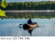 Купить «Morning summer lake landscape with plants reflections on water surface and boat with fisherman», фото № 29744146, снято 11 июня 2017 г. (c) Евгений Бобков / Фотобанк Лори