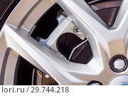 Купить «Super Car Brakes. Disc Brake. Disc Pads, Part of modern new wheel car with disk brake pad, Caliper Assembly. Car Brakes Close-up Photo.», фото № 29744218, снято 31 марта 2018 г. (c) Евгений Бобков / Фотобанк Лори