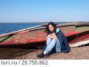 Купить «Brunette girl in a jacket in the fall near a boat on the bank of the Amur River, below the village of Sikachi-Alyan», фото № 29750862, снято 30 сентября 2018 г. (c) Катерина Белякина / Фотобанк Лори
