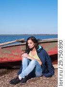 Купить «Brunette girl in a jacket in the fall near a boat on the bank of the Amur River, below the village of Sikachi-Alyan», фото № 29750890, снято 30 сентября 2018 г. (c) Катерина Белякина / Фотобанк Лори