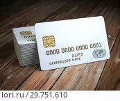 Купить «Stack of white blank credit cards mockup on wooden table background.», фото № 29751610, снято 16 июня 2019 г. (c) Maksym Yemelyanov / Фотобанк Лори